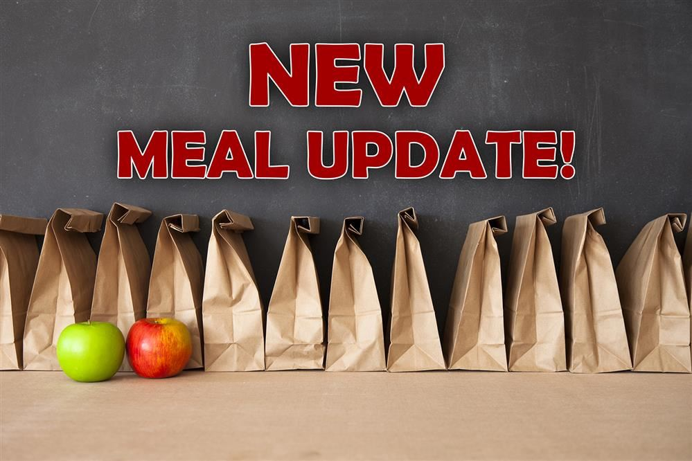 NEW MEAL UPDATE - row of bag lunches and apples