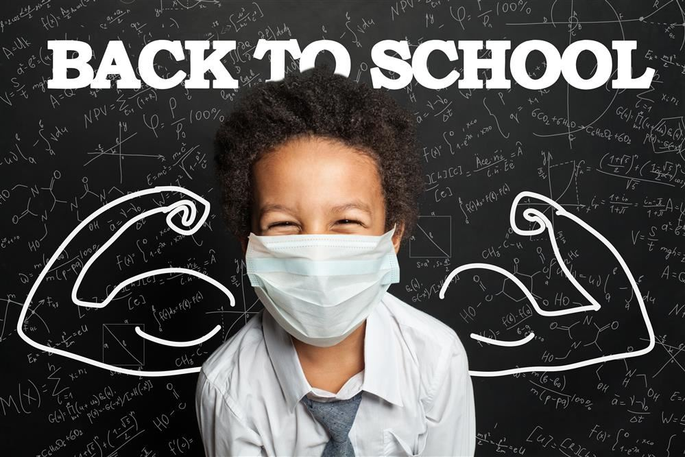 "Back to School ""strong"" student in front of chalkboard with mask"