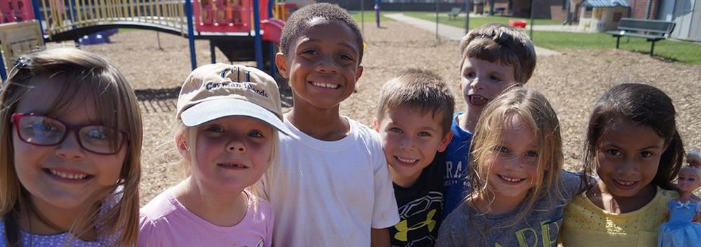 pathways elementary students standing on the playground