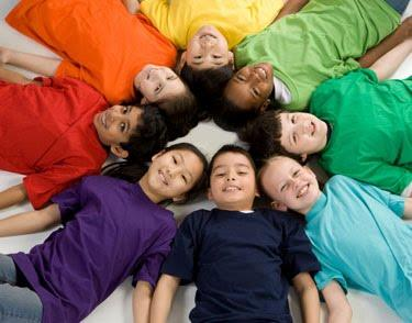 students with colorful shirts in a circle