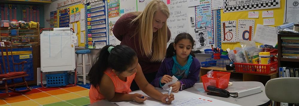 orange county schools student teacher working with students